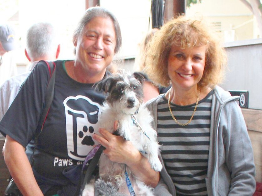 Jackie Newman and Gloria Warren with their Terrier-mix, Pistolo, attend the Paws & Pints event May 28, 2015 at La Jolla Brewing Co.