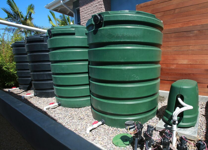 Rain barrels and a drip-irrigation system at a home in Pacific Beach.