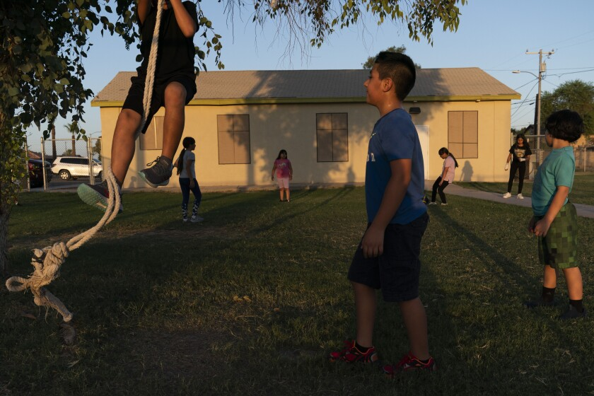 Children play in the yard of a community boxing club in Somerton, Ariz.