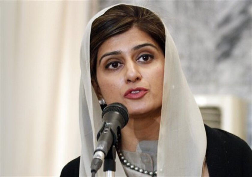 Pakistan Foreign Minister Hina Rabbani Khar speaks during a joint press conference with her Afghan counterpart Zalmai Rasool, unseen, at the foreign ministry in Kabul, Afghanistan, Wednesday, Feb. 1, 2012. (AP Photo/Ahmad Jamshid)