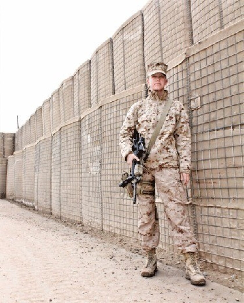 Capt. Zoe Bedell of the Marine Corps, left active-duty service because her career had been limited. She is one of four servicewomen joining a lawsuit filed Nov. 27 challenging the Pentagon's policy excluding women from combat positions.