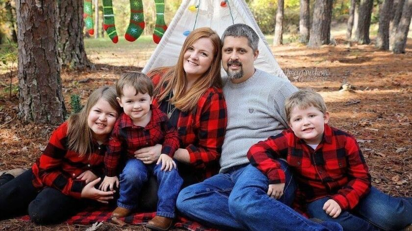 Josh Pinkard, 37, second from right, and his family in an undated photo. Pinkard was a victim of the