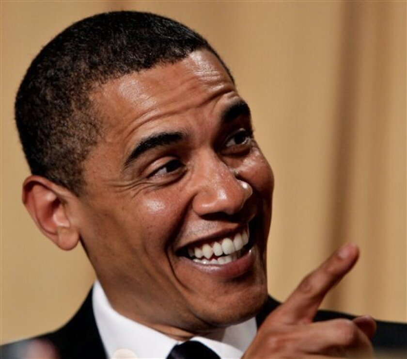 President Barack Obama reacts with laughter to comic actess Wanda Sykes who entertained the annual White House Correspondents' Association dinner at the Hilton Hotel in Washington, Saturday, May 9, 2009. (AP Photo/J. Scott Applewhite)