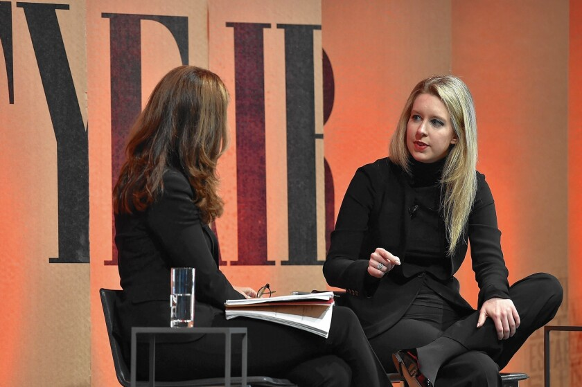Elizabeth Holmes, right, founder and chief executive of blood-testing firm Theranos Inc., with NBC News' Maria Shriver at a Vanity Fair event in October.