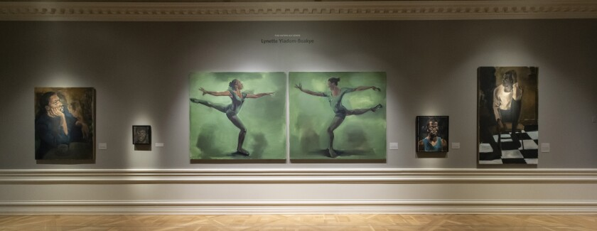 An installation view of Lynette Yiadom-Boakye's paintings at the Huntington Library