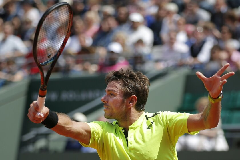 Switzerland's Stan Wawrinka returns in his second round match of the French Open tennis tournament against Japan's Taro Daniel at the Roland Garros stadium in Paris, France, Wednesday, May 25, 2016. (AP Photo/Christophe Ena)