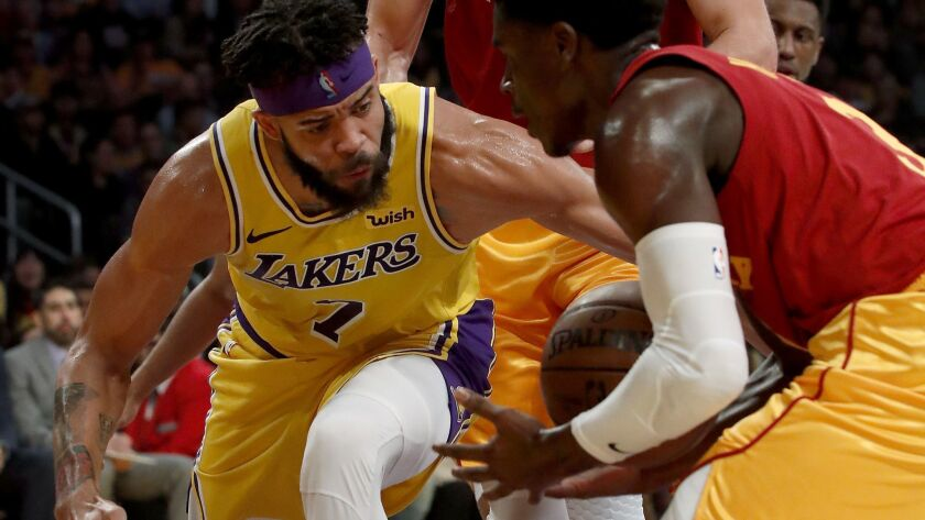 LOS ANGELES, CALIF. - NOV. 29, 2018. Lakers center JaVale McGee fights for control of the ball wit