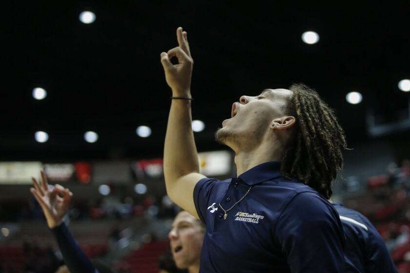 UCSD guard Tyrell Roberts cheers from the bench after a three pointer against SDSU last season.