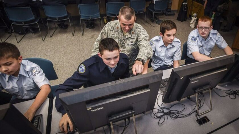 Maj. Trevor Cook, ICBM Systems Directorate Cyber Division deputy chief, mentors cadets at the Utah Military Academy, Riverdale, Utah, Jan. 5.