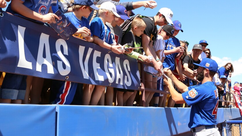Chicago Cubs pitcher Jake Arietta signs autographs at Cashman Field in downtown Las Vegas prior to an exhibition game in March. The world champion Cubs will return to Sin City next spring for the 13th consecutive year.