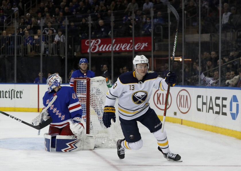 Buffalo Sabres left wing Jimmy Vesey (13) reacts after scoring a goal against New York Rangers goaltender Alexandar Georgiev (40) during the third period of an NHL hockey game, Friday, Feb. 7, 2020, in New York. (AP Photo/Jim McIsaac)