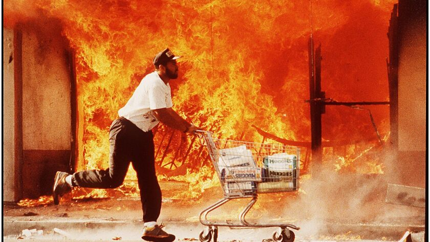 Critics say police gave up when the rioting erupted in 1992, letting big chunks of the city burn whi