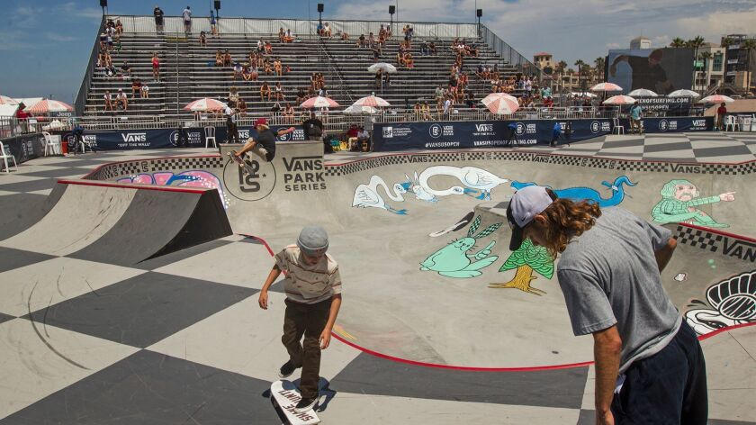 Competitors warm up in the Vans Park Series skateboarding area.