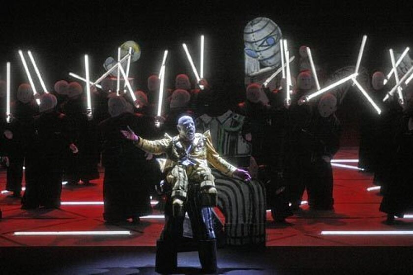 "Not your father's opera: Eric Halfvarson as Hagen and the ensemble in Act II of Los Angeles Opera's production of ""Gotterdammerung"" at the Dorothy Chandler Pavilion."