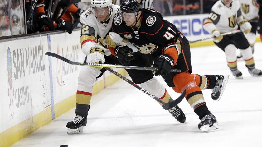Ducks defenseman Hampus Lindholm battles Vegas' Tomas Nosek for the puck Friday.