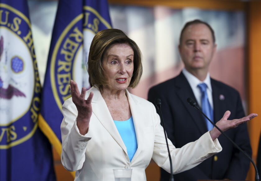 Speaker of the House Nancy Pelosi, D-Calif., joined at right by House Intelligence Committee Chairman Adam Schiff, D-Calif., announces her appointments to a new select committee to investigate the violent Jan. 6 insurrection at the Capitol, on Capitol Hill in Washington, Thursday, July 1, 2021. The probe will examine what went wrong around the Capitol when hundreds of supporters of then-President Donald Trump broke into the building, hunted for lawmakers and interrupted the congressional certification of Democrat Joe Biden's election victory. (AP Photo/J. Scott Applewhite)