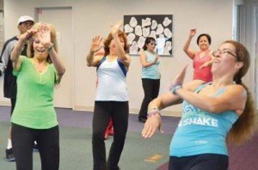 Zumba instructor Gerty Rey, far right, leading the Jan. 3 class at Rancho Bernardo Library, which included students, from left, Ruth Castillo and Mildred Mata. Photo by Elizabeth Marie Himchak
