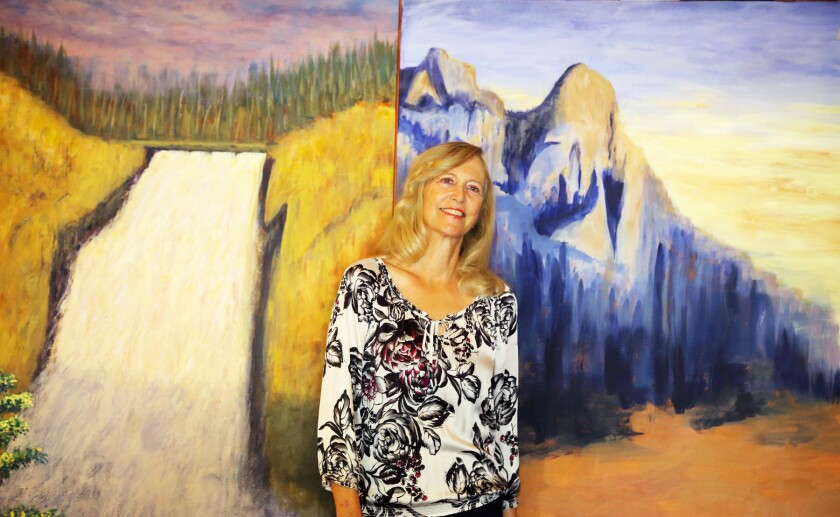 Therese Verner with the new painting she made for her PCPA exhibit.