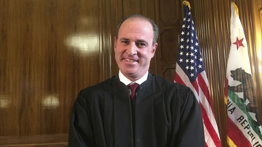 California Gov. Jerry Brown's senior legal adviser, Joshua Groban, who grew up in Del Mar, posed for a photo as he was sworn in as California's newest Supreme Court justice in Sacramento on Jan. 3, 2019. It was one of Brown's last official acts before leaving office this week.