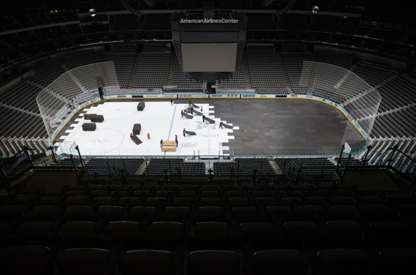 Crews cover the ice at American Airlines Center in Dallas after the NHL season was put on hold on March 12 because of the coronavirus.