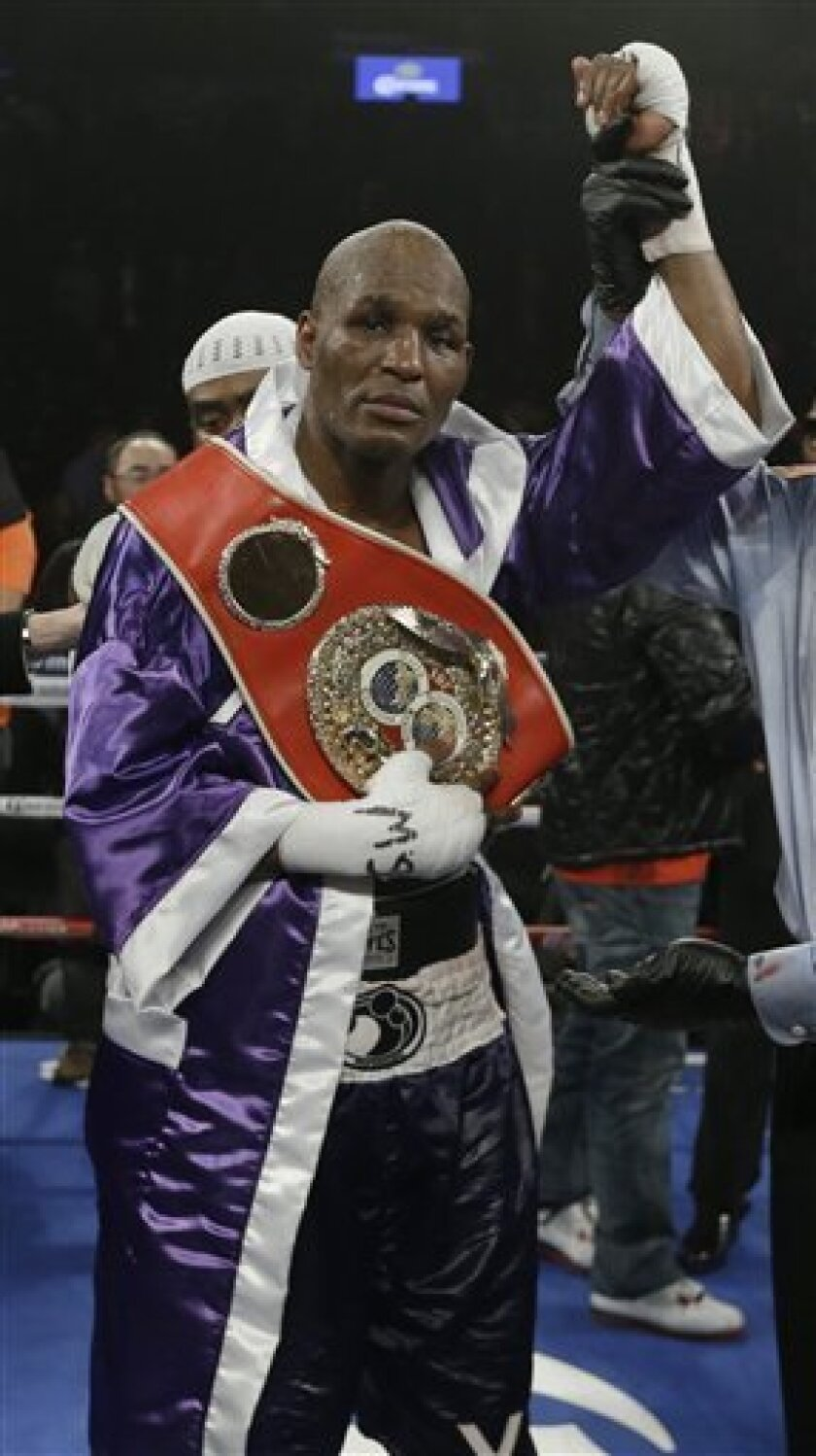 Bernard Hopkins poses for photographs after an IBF Light Heavyweight championship boxing match against Tavoris Cloud at the Barclays Center Saturday, March 9, 2013, in New York. Hopkins won by unanimous decision. (AP Photo/Frank Franklin II)