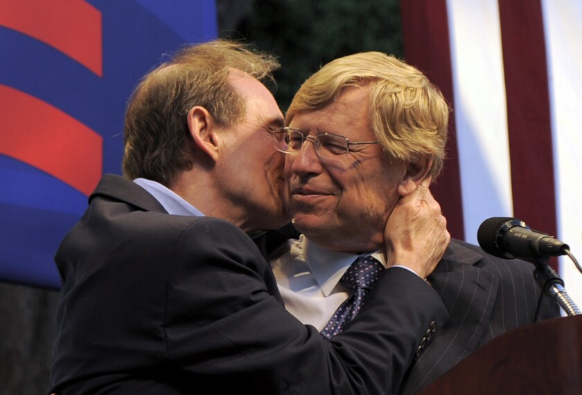"""Attorney David Boies, left, kisses fellow lawyer Ted Olson on the cheek in 2010 at a rally in West Hollywood. The two, who had worked on opposite sides of the presidential-election-determining Bush v. Gore case in 2000, teamed to defeat California's gay-marriage ban. That effort is chronicled in """"The Case Against 8."""""""