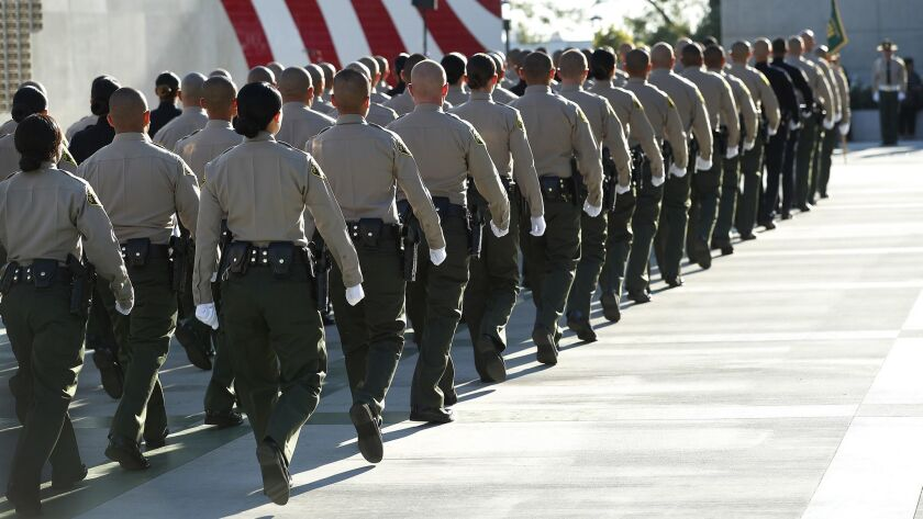LOS ANGELES, CA-OCTOBER 27, 2017: Los Angeles County Sheriffs deputies walk in formation during the