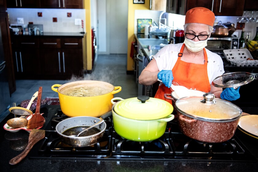 Mehri Azadi cooks food in her home kitchen.