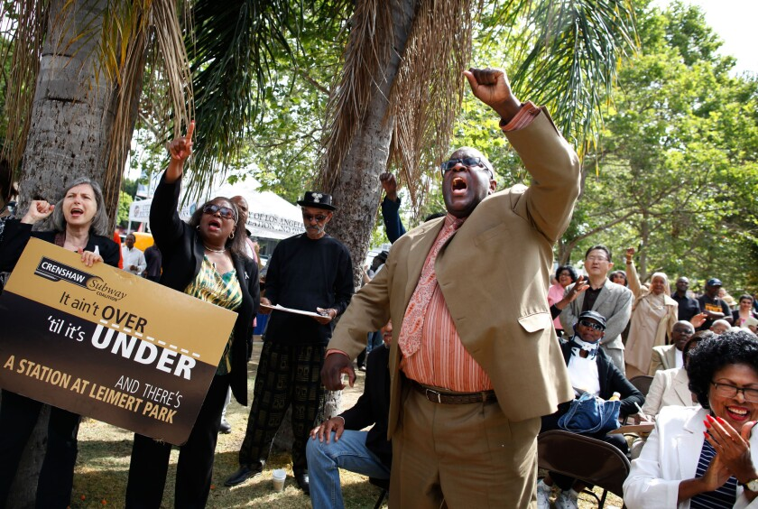 Pastor William Smart cheers on during a celebration of the MTA board approval of funding for a Leimert Park Village Station on the Crenshaw/LAX light rail line.