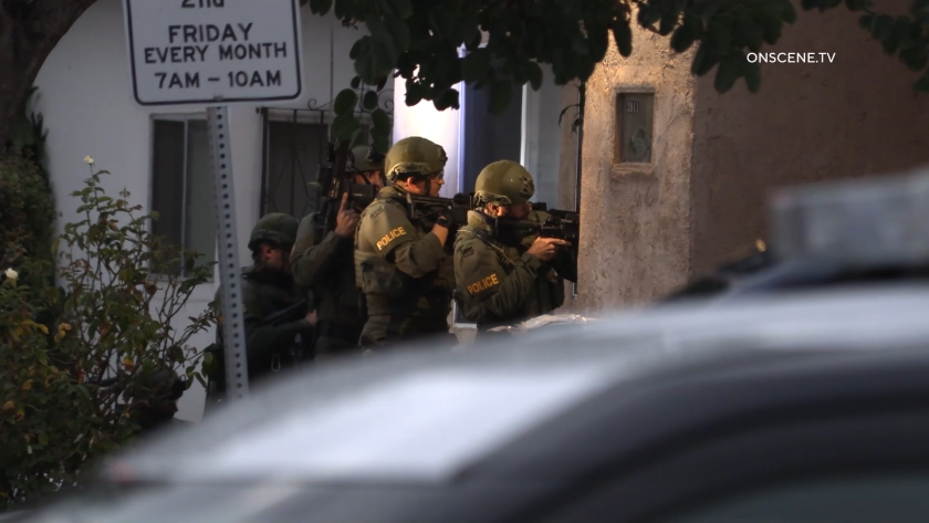 SWAT officers served search warrants at two houses in the Mountain View neighborhood of San Diego.