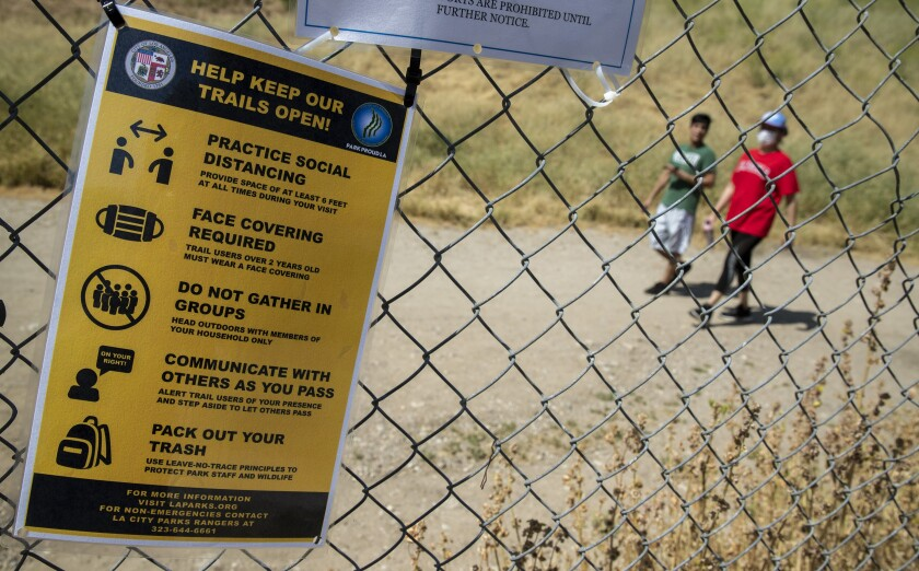 Hikers at El Scorpion Park take advantage of newly reopened trails on Saturday in West Hills.