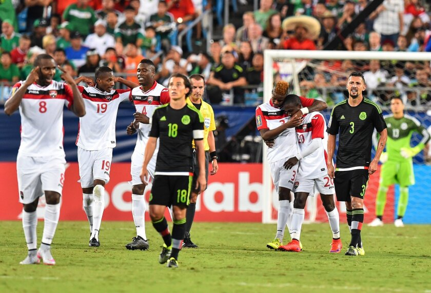 Trinidad and Tobago's Keron Cummings (3rd R) and Joevin Jones celebrate Cummings' goal against Mexico during a CONCACAF Gold Cup Group C match in Charlotte, North Carolina, on July 15, 2015. AFP PHOTO/NICHOLAS KAMMNICHOLAS KAMM/AFP/Getty Images ** OUTS - ELSENT, FPG - OUTS * NM, PH, VA if sourced by CT, LA or MoD **