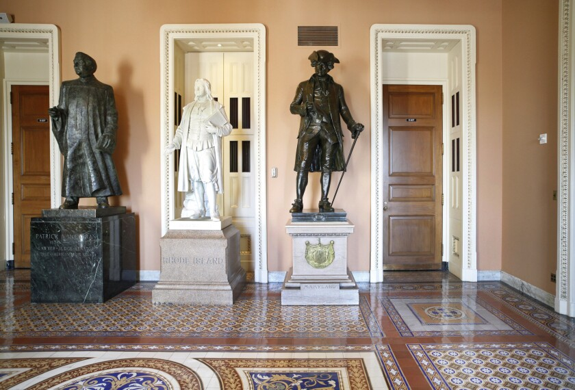 "FILE - In this March 28, 2011, file photo, a larger-than-life bronze statue of Patrick A. McCarran of Nevada, left, stands near the entrance to the Senate floor on Capitol Hill in Washington. Democratic members of Nevada's congressional delegation are renewing a proposal to remove a statute of a former Nevada Sen. McCarran from the U.S. Capitol's Statuary Hall, saying that he left a ""legacy of racism, anti-Semitism, and xenophobia."" (AP Photo/J. Scott Applewhite, File)"