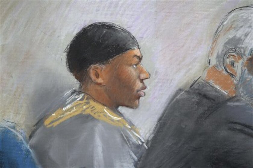 In this courtroom drawing, Umar Farouk Abdulmutallab appears in U.S. District Judge Nancy Edmunds' courtroom Tuesday, Oct. 11, 2011, in Detroit. Opening arguments in the trial of the Nigerian man accused of trying to bring down a jetliner with a bomb in his underwear were heard Tuesday. (AP Photo/Jerry Lemenu)