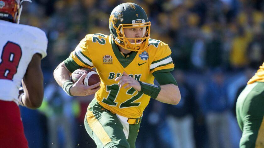 North Dakota State quarterback Easton Stick picks up yards against Eastern Washington during the first half Saturday.