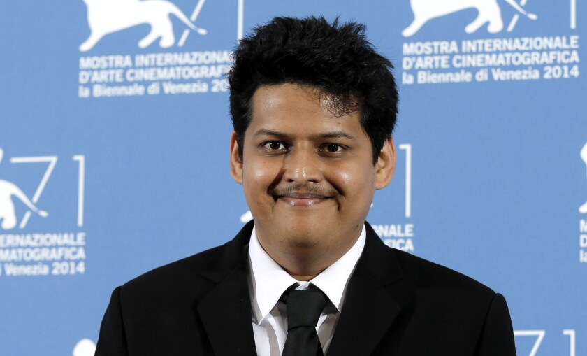 """FILE - Chaitanya Tamhane poses during a photo call for """"Court"""" at the 71th edition of the Venice Film Festival on Sept. 6, 2014, in Venice, Italy. Writer-director Tamhane's """"The Disciple,"""" a film about a classical musician's struggle to balance his career dreams and life in contemporary Mumbai, will return India to the main competition at the upcoming Venice Film Festival for the first time in nearly two decades. (AP Photo/Andrew Medichini, File)"""