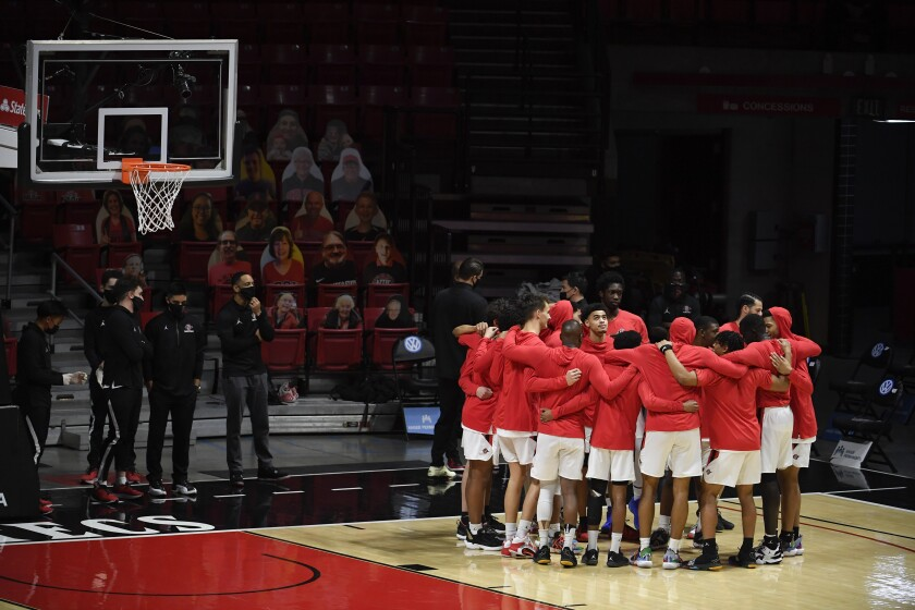 SDSU players huddle before Saturday's 62-58 win against Boise State at Viejas Arena.