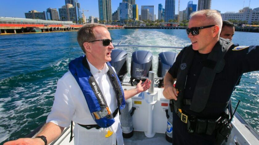 Ambassador William R. Brownfield, assistant secretary of state at the Bureau of International Narcotics and Law Enforcement Affairs, left, and San Diego Harbor Police Chief John Bolduc, right, discuss the Port of San Diego's partnership with the State Department.