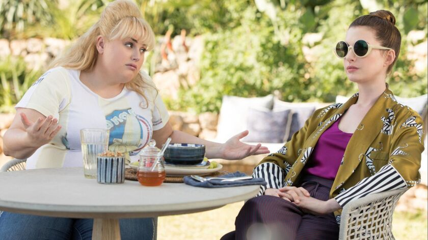 "Rebel Wilson, left, and Anne Hathaway in the movie ""The Hustle."""
