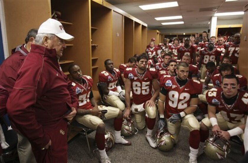 Florida State head coach Bobby Bowden, left, talks to his players in the locker room prior to the start of the Gator Bowl NCAA college football game against West Virginia, Friday, Jan. 1, 2010, in Jacksonville, Fla.(AP Photo/Phil Coale)