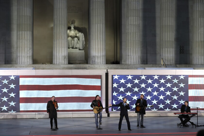 "Lee Greenwood, third from left, sings with the backing of the Frontmen of Country at a pre-inaugural ""Make America Great Again! Welcome Celebration"" at the Lincoln Memorial in Washington on Jan. 19."