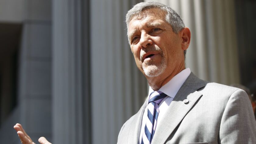 SAN DIEGO, September 21, 2018 | Attorney Doug Applegate speaks to the media after he and family memb