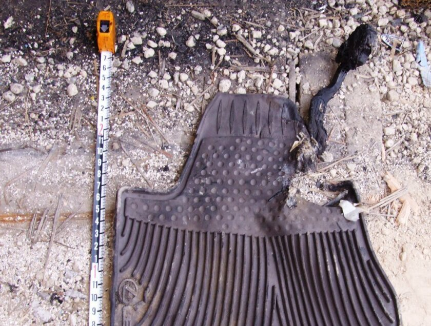 A wrong-size driver-side floor mat has been blamed for the Lexus crash. Photo was taken by federal investigators in the wake of the Saylor crash.