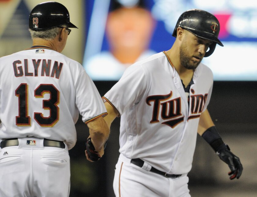Minnesota Twins' Trevor Plouffe, right, get congratulations from third base coach Gene Glynn (13) after hitting a two-run home run off Chicago White Sox pitcher Jose Quintana during the fifth inning of a baseball game, Thursday, Sept.. 1, 2016, in Minneapolis. (AP Photo/Tom Olmscheid)