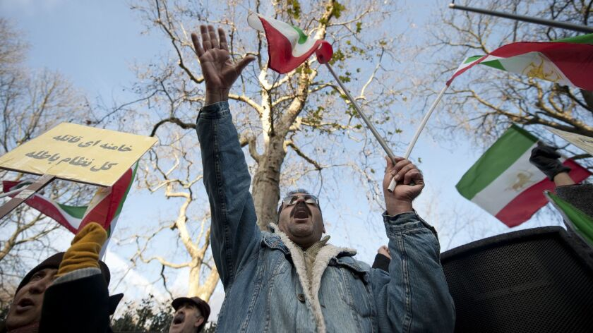 Supporters of the Peoples Mojahedin Organisation of Iran demonstrate outside the Iranian Embassy in