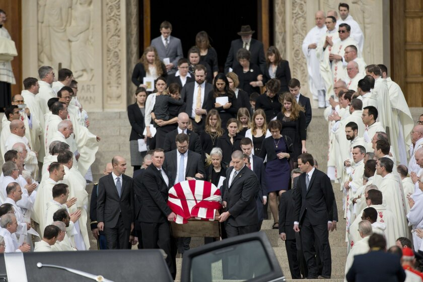 The casket containing the body of the late Supreme Court Associate Justice Antonin Scalia leaves the Basilica of the National Shrine of the Immaculate Conception in Washington following funeral mass services, Saturday, Feb. 20, 2016. (AP Photo/Pablo Martinez Monsivais)