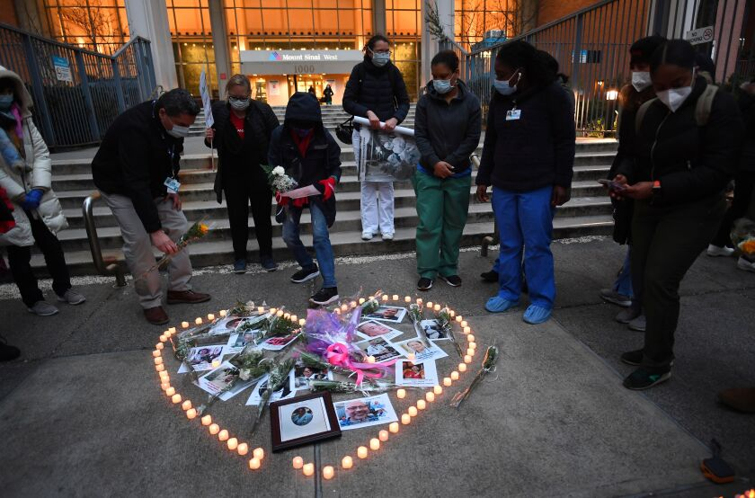 Healthcare workers memorial to COVID-19 victims at a New York hospital in April.