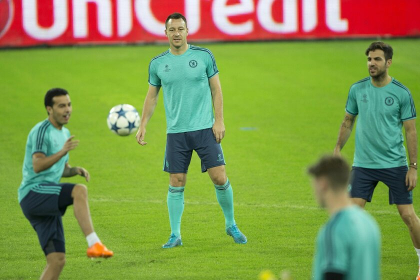 Chelsea's John Terry, center, looks as Chelsea's Pedro Rodriguez, left, plays with the ball while Chelsea's Cesc Fabregas, right, looks on during training session ahead of group G Champions League soccer match in Haifa, Israel, Monday, Nov. 23, 2015. Chelsea will play against Maccabi Tel Aviv on Tuesday. (AP Photo/Ariel Schalit)