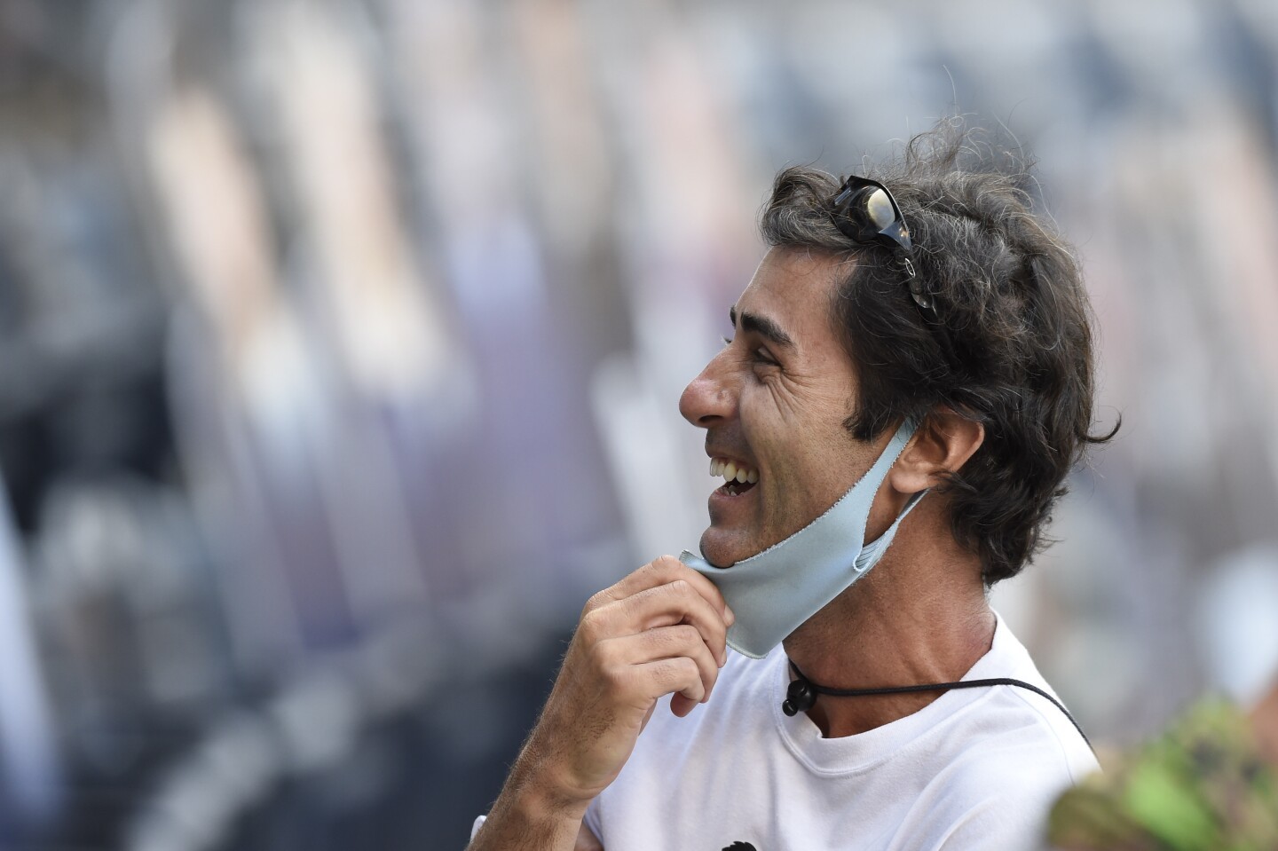 San Diego Padres general manager AJ. Preller laughs after the Padres beat the Seattle Mariners 7-4 in a baseball game Sunday, Sept. 20, 2020, in San Diego. The Padres clinched a spot in the playoffs. (AP Photo/Denis Poroy)