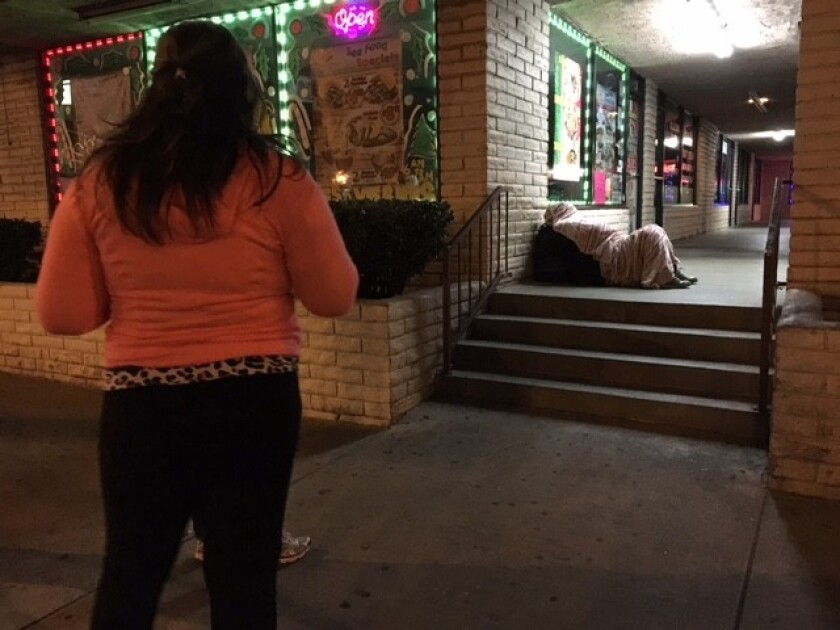 Volunteer Victoria Covarrubias notes a homeless man on Whittier Boulevard during the homeless count.